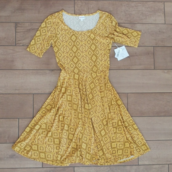 LuLaRoe Dresses & Skirts - Lularoe yellow patterned Nicole dress size small